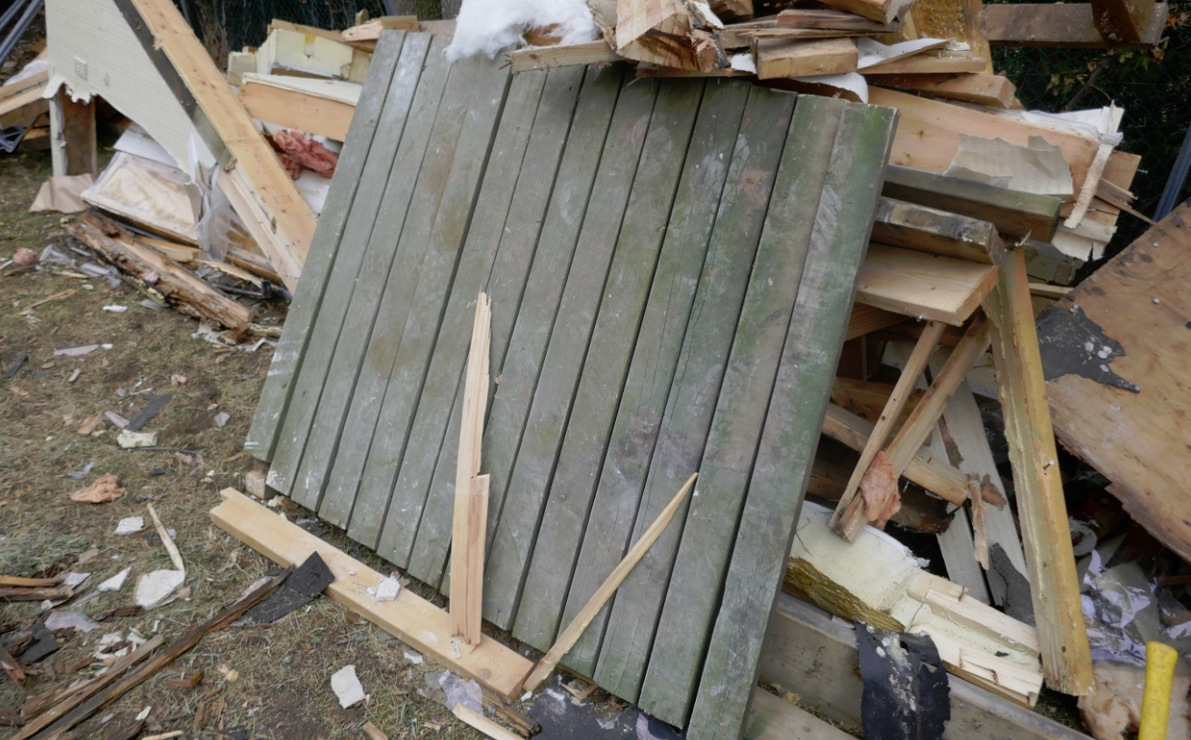 wood deck scraps bound for disposal in bin