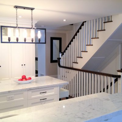 stairs in kitchen divide living room house interior