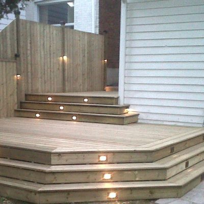 wooden steps deck behind house - finish carpentry