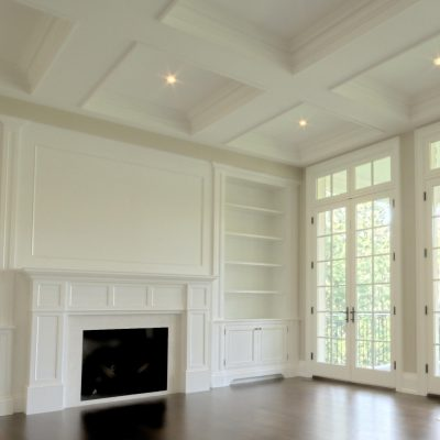 finish carpentry great room with french doors, fireplace, bookcase