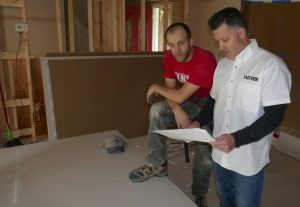 Matt, Keith review home addition building plans
