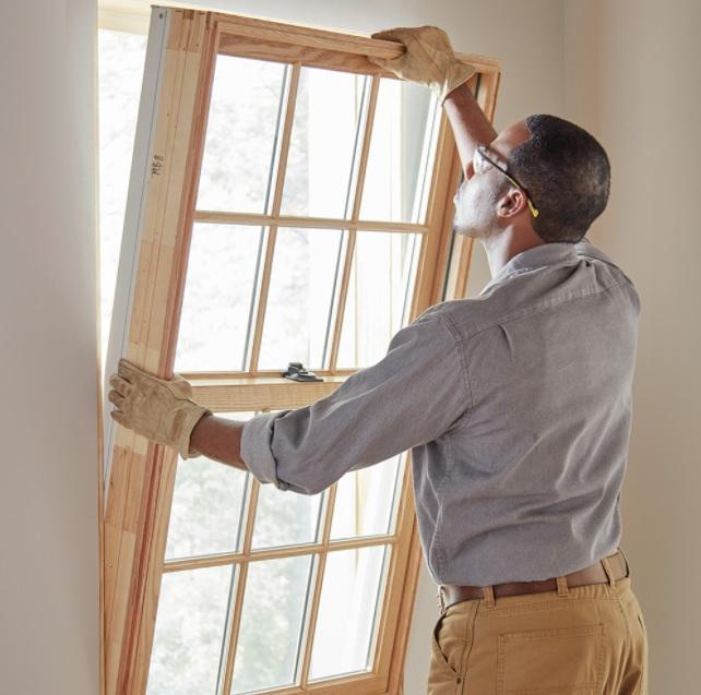 Installing window at Eastview Oakville