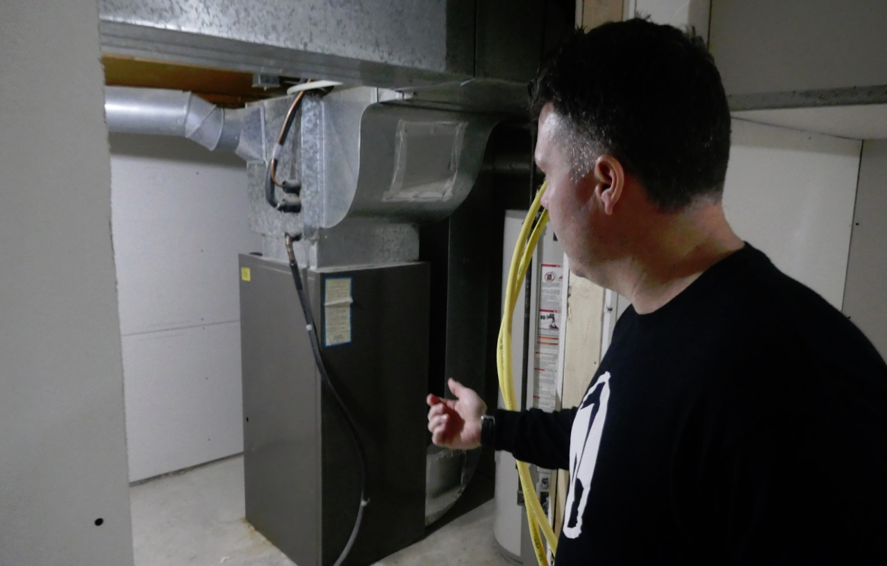 basement mid efficiency furnace with vent pipe