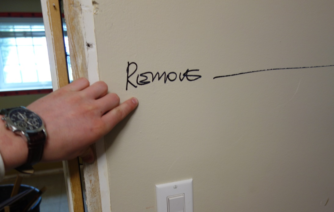 site manager leaves notes on the drywall for demolition crew
