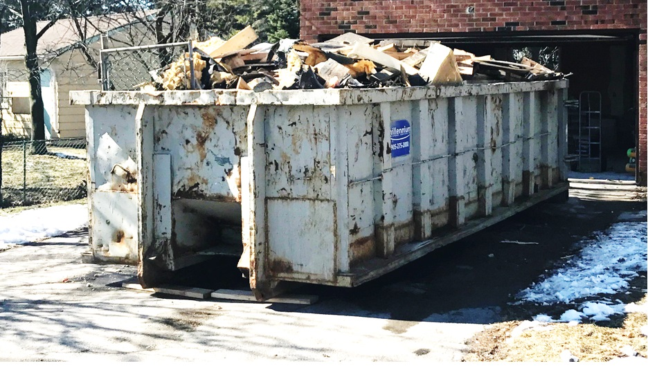 Bins full of detrius from demolitions in Burlington